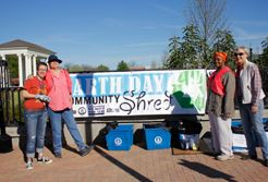 Community Shred Volunteers with banner