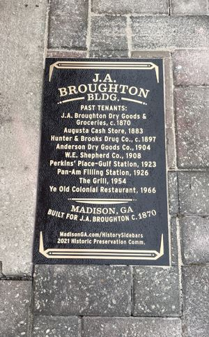 Broughton Building sidewalk plaque